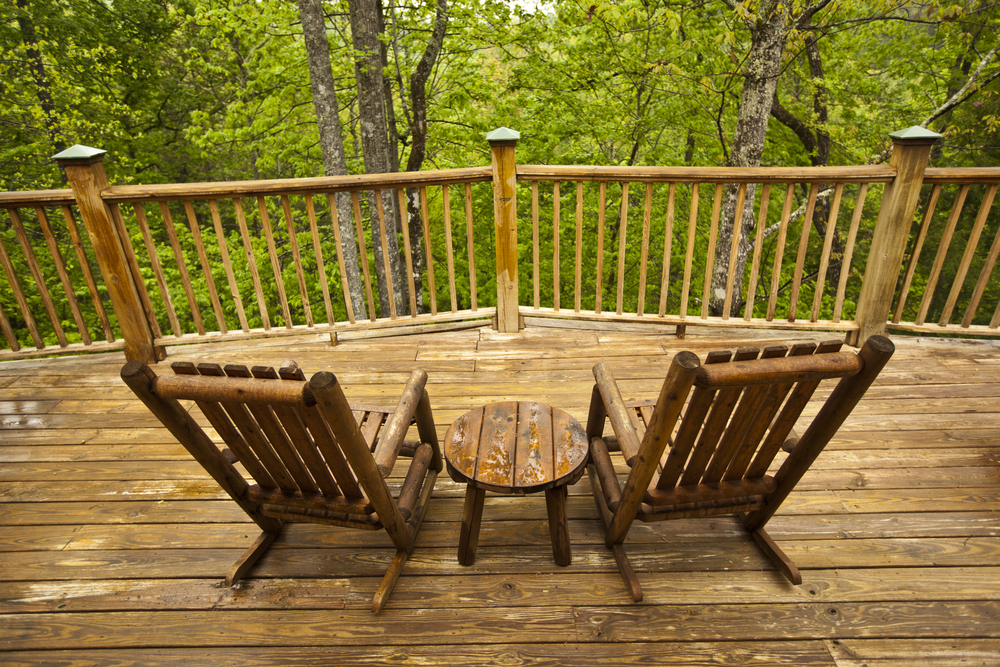 Wooden chairs on cabin porch